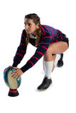 Female athlete keeping rugby ball on tee Royalty Free Stock Images
