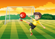 A female athlete kicking ball with flag of Turkey Stock Photos
