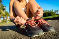 Female athlete lacing running footwear Stock Photo