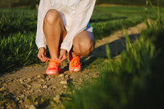 Female athlete lacing running shoes Royalty Free Stock Photos