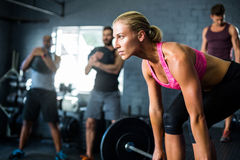 Female athlete lifting barbell Stock Photos