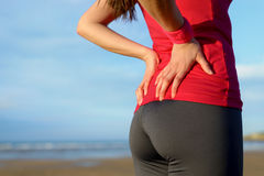 Runner lower back pain injury Royalty Free Stock Images