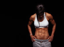 Female athlete with muscular abs Royalty Free Stock Images