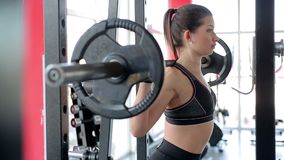 Female athlete with muscular body training in gym before sports competition. Stock footage stock video
