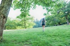 Female athlete on park. Jog workout well being Stock Image