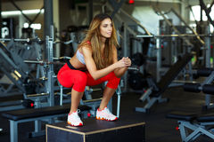 Female athlete is performing box jumps at gym Stock Photos