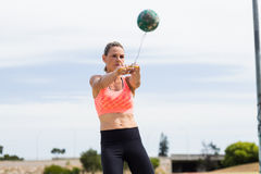Female athlete performing a hammer throw. In stadium royalty free stock images