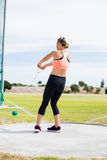 Female athlete performing a hammer throw. In stadium royalty free stock photography