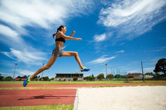 Female athlete performing a long jump Royalty Free Stock Photography