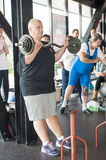 Female athlete performing the strict curl Stock Photos