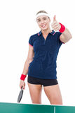 Female athlete playing ping pong and showing thumbs up Stock Photos