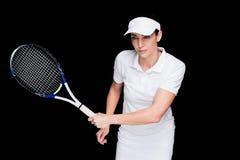 Female athlete playing tennis royaltyfri bild