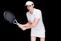 Female athlete playing tennis fotografering för bildbyråer