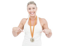 Female athlete pointing her medal Royalty Free Stock Images