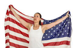 Female athlete posing with american flag Royalty Free Stock Photography