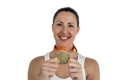 Female athlete posing with gold medals after victory Royalty Free Stock Images