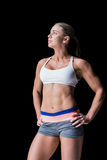 Female athlete posing with hands on hip Royalty Free Stock Photos