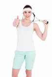 Female athlete posing with tennis racket and showing thumbs up Stock Image