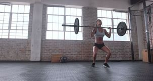 Female athlete practicing deadlift with weight bar stock footage