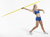 Female Athlete Preparing To Throw Javelin Royalty Free Stock Photos