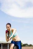 Female athlete preparing to throw shot put ball Royalty Free Stock Images