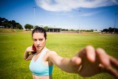 Female athlete preparing to throw shot put ball Stock Photos