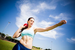 Female athlete preparing to throw shot put ball royalty free stock photo