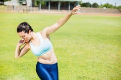 Female athlete preparing to throw shot put ball Royalty Free Stock Photo
