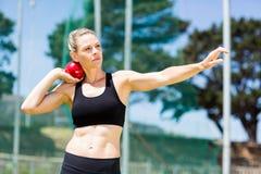 Female athlete preparing to throw shot put ball Royalty Free Stock Photography
