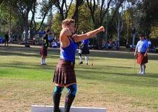 Female Athlete preparing to throw the stone Stock Photos
