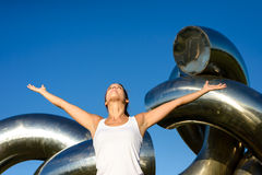 Female athlete raising arms to the sky Royalty Free Stock Photography