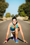 Female athlete ready for sprint running Royalty Free Stock Photos