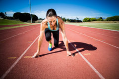 Female athlete in ready to run position royalty free stock photography