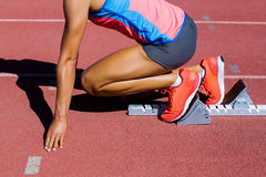 Female athlete ready to run on running track Royalty Free Stock Image