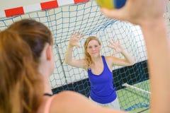 Female athlete ready to shoot handball goal Stock Photo