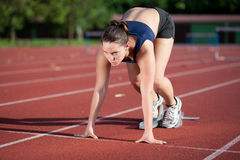 Female athlete ready to start Royalty Free Stock Image