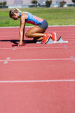 Female athlete ready to start the relay race Stock Photography