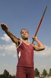 Female Athlete Ready To Throw Javelin. Confident African American female athlete ready to throw javelin Royalty Free Stock Photo