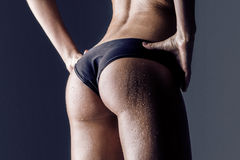 Female athlete rear view, trained buttocks Stock Image