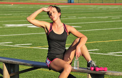 Female athlete resting Royalty Free Stock Image