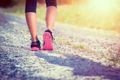 Female athlete runner. closeup on shoes Stock Photos