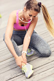 Female athlete runner touching foot in pain outdoors Stock Image