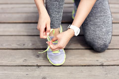 Female athlete runner tying shoelaces. Picture of female athlete runner tying shoelaces Royalty Free Stock Photos