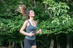 Female athlete running on park. Female athlete running on camaldoli park Stock Photography