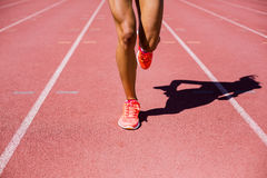 Female athlete running on the racing track Stock Photography