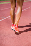 Female athlete running on the racing track Royalty Free Stock Photo
