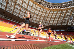 Female athlete running in the stadium Stock Image
