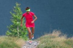 Female athlete running trail trains royalty free stock photo