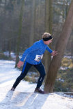 Female athlete running up a hill Stock Image
