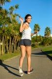 Female athlete running and waving Royalty Free Stock Image